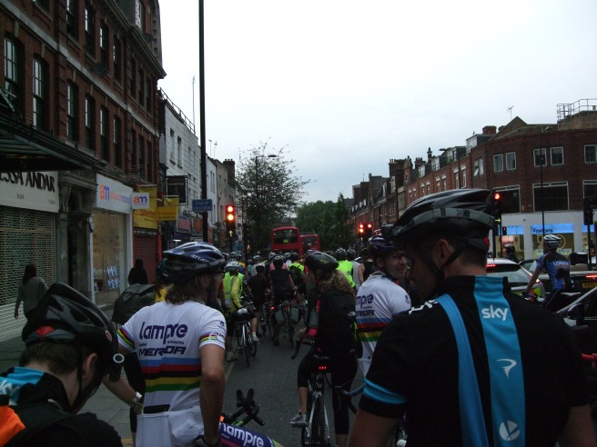 100s of riders in a long line here we wait at a red light in Hackney