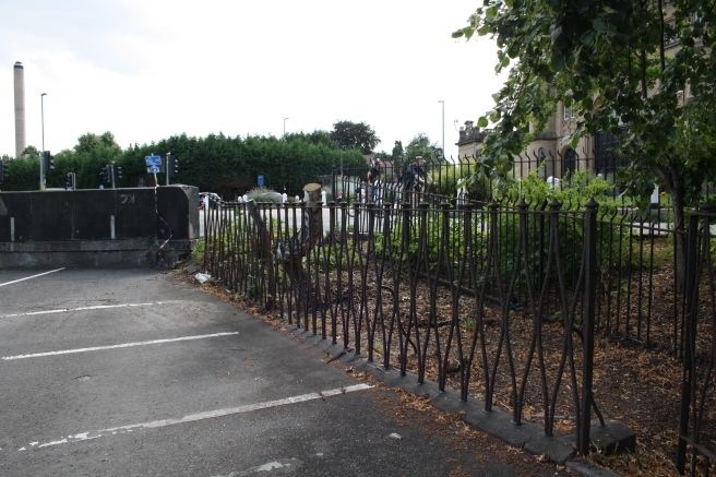 Another view of the railings that make little sense without the canal there to protect.
